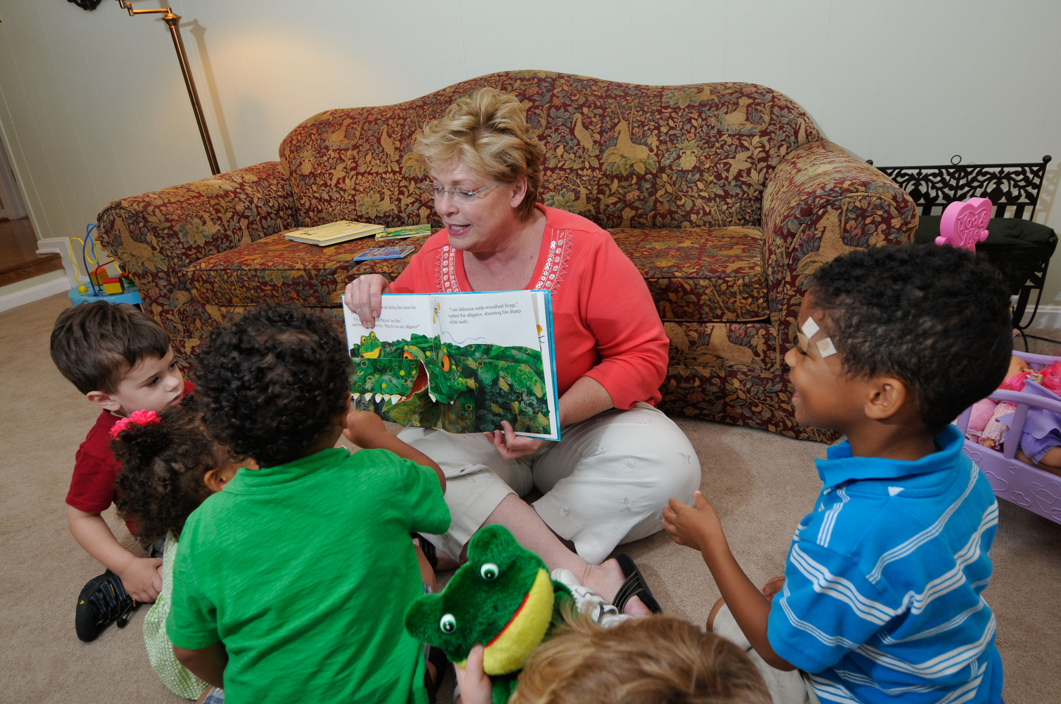 Teacher reads to a group of students in a Family Child Care Home