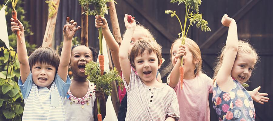 Children holding vegetables