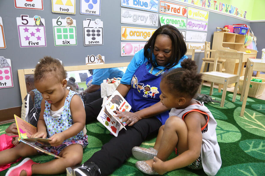 a teacher reads to young learners