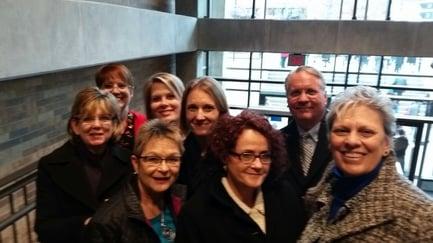 Front: Deb Crowl, Cheryl Firsching, Leadell Ediger Middle row: Elaine Edwards, Tanya Koehn, Dean Olson Back row: Reva Wywadis and Angie Saenger