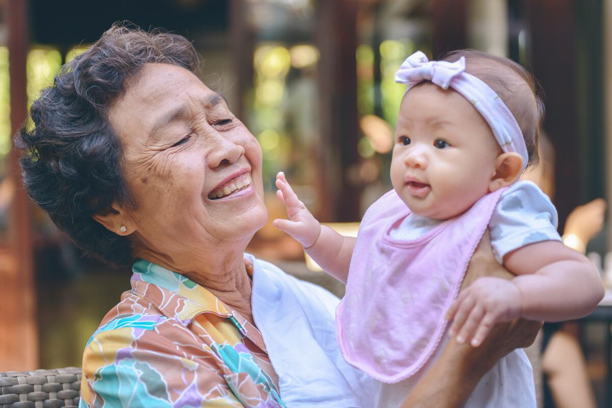 Grandmother with baby granddaughter