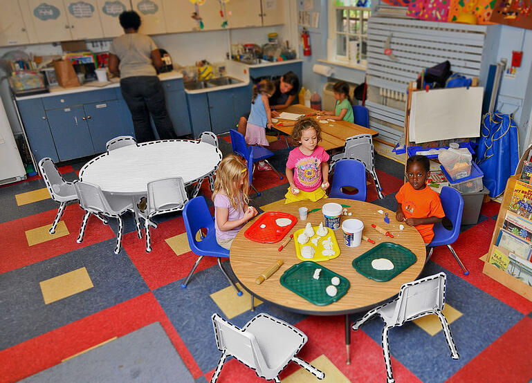 empty tables and chairs in an early learning program
