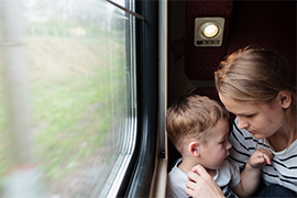 mother and son on train