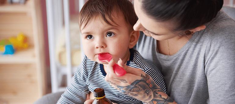 Provider giving child medicine