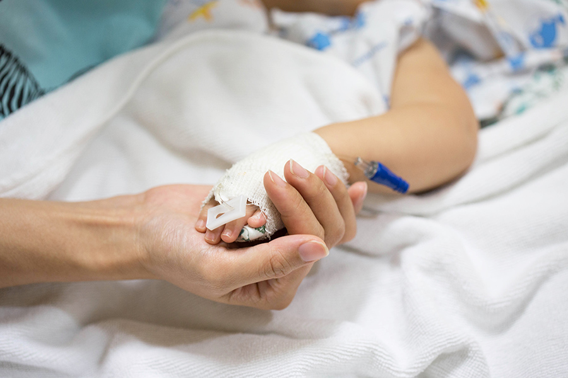 parent holding child hand
