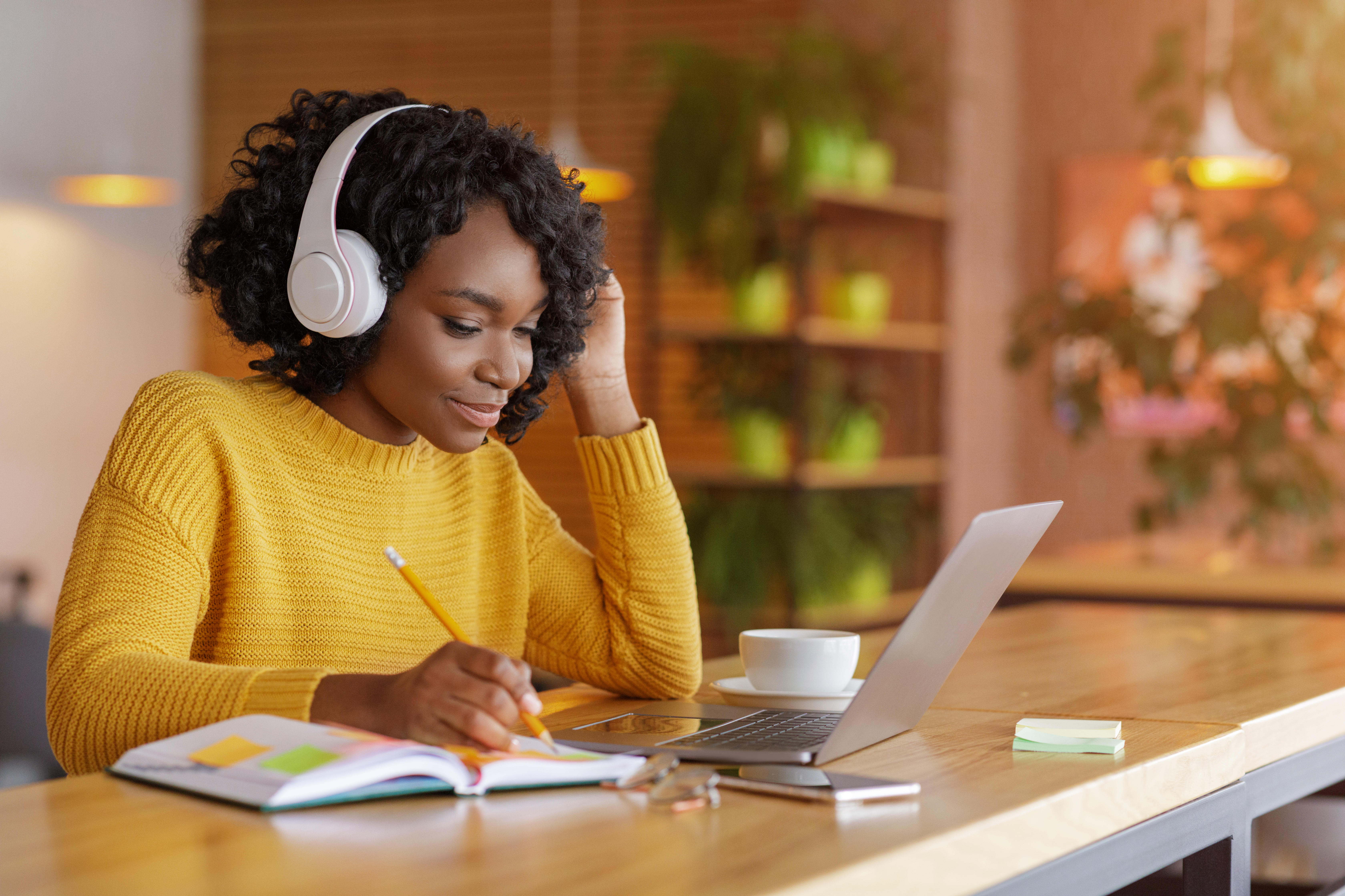 smiling-black-girl-with-headset-studying-online-us-ZB9E52C